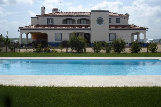 Farm house with outbuildings and pool
