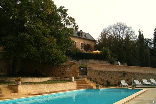 Property with pool and garden