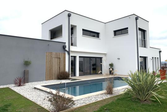 Contemporary house with pool and garden